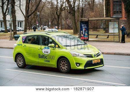 Riga, Latvia - December 13, 2016: Toyota Verso Car From Baltic Taxi Moving On Kalpaka Boulevard Street In Riga, Latvia
