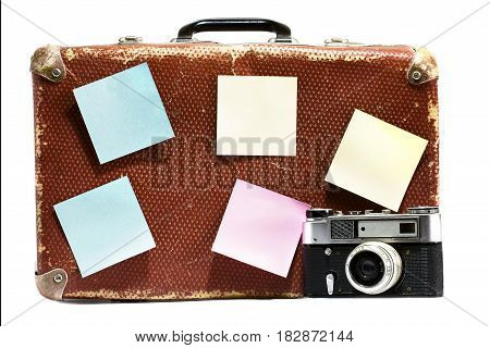 Old vintage suitcase and old camera on a white background. Isolated
