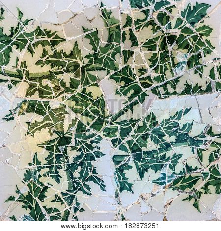Broken glass mosaic tile decoration in Park Guell, Barcelona Spain. Designed by Gaudi