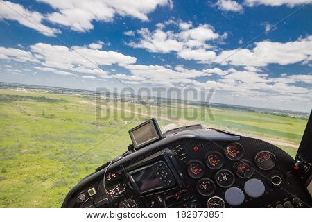 View from the cockpit of a light private plane while performing a leisure flight in summer