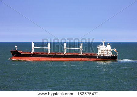 Cargo bulker ship sailing in sea, transport