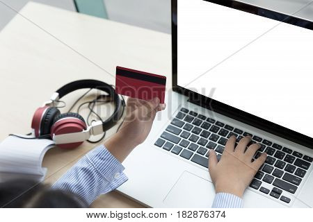 Young Asian Girl Holding Credit Card On Laptop For Internet Online Shopping