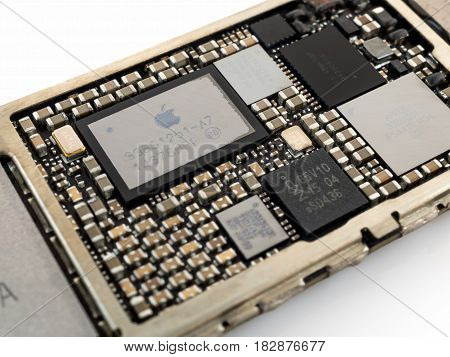 Chiang Rai Thailand: April 8 2017 - Close-up image of power management IC chip on Apple iPhone 6 or iPhone 6plus logic board. Selective focus