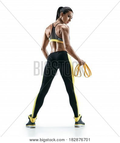 Athletic woman showing muscles of the back and hands after exercises with resistance band. Photo of young woman isolated on white background. Strength and motivation