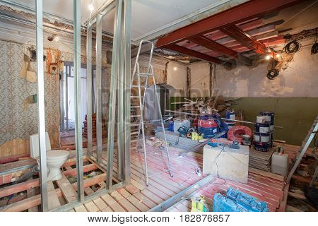 Interior of apartment with materials during on the renovation and construction ( remodel wall from gypsum plasterboard or drywall)