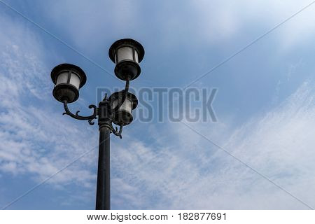 Vintage classic street light lamp decoration with clear blue sky