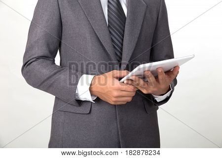 Young Asian Startup Entrepreneur Businessman Wearing Gray Suit Using Digital Tablet Touchpad Over Wh