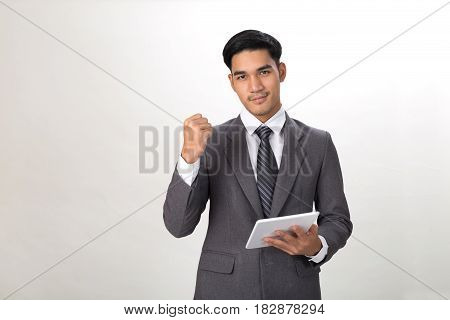 Young Asian Startup Entrepreneur Businessman Wearing Gray Suit Holding Digital Tablet Touchpad With