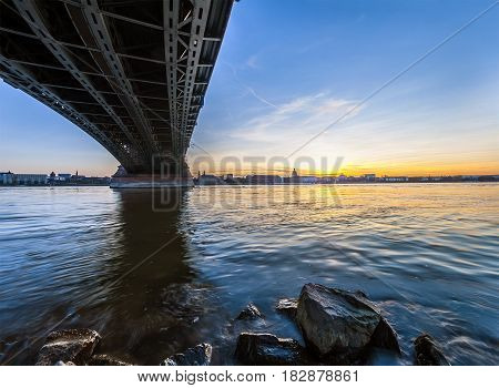 Beautiful sunset over Rhine / Rhein river and old bridge in Mainz near Frankfurt am Main Germany.