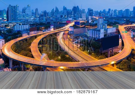 Opening wooden floor Aerial view highway intersection with city downtown background Bangkok City Thailand