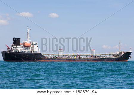 Transportation ship in ocean skyline Oil transportation logistic boat