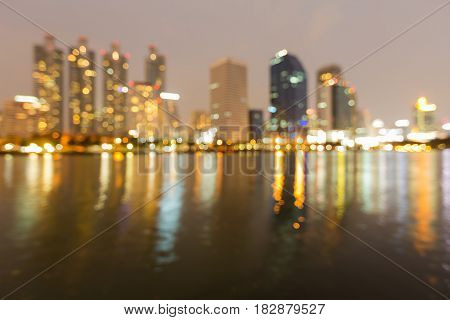 Abstract blurred bokeh light office building water front abstract background