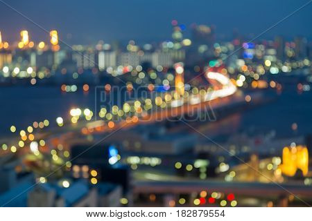 Twilight blurred bokeh Kobe city road and central business skyline abstract background