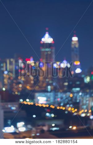 Twilight blurred bokeh light office building abstract background