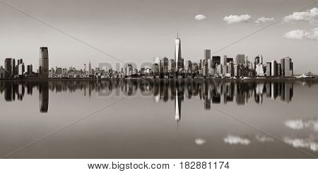 Manhattan downtown skyline with urban skyscrapers over river with reflections.
