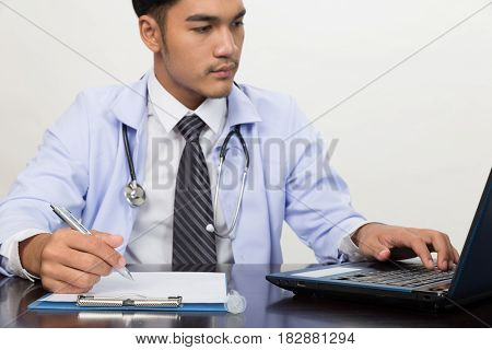 Doctor Writing Rx Prescription In Medical Office Clinic On Desk, Stethoscope With Clipboard
