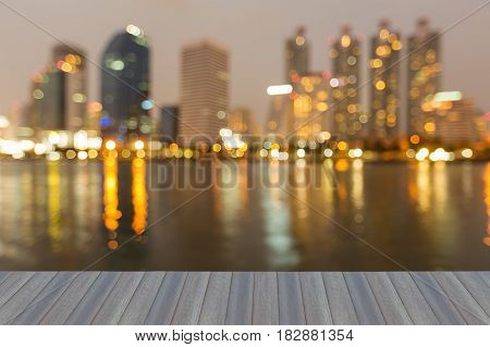 Opening wooden floor City office building blurred bokeh light night view abstract background