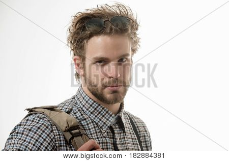 Handsome man or smart male student businessman with beard and stylish blond hair in nerd glasses on head and checkered shirt with suspenders. Study and knowledge