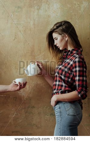 Pretty Girl Pouring Tea To Cup In Male Hand