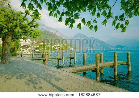 Lake Lucerne Switzerland. Weggis wooden piers over maintains