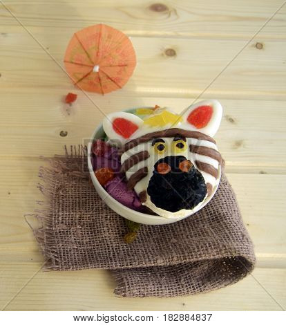 The zebra is made of ice cream. A creative dessert for children and good mood.