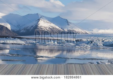 Opening wooden floor Beauty Iceland winter season lagoon and mountain nautral landscape background