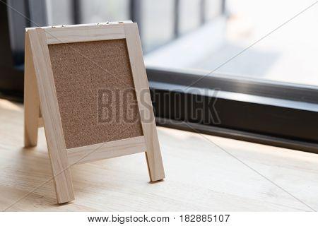Corkboard On A Wooden Table.