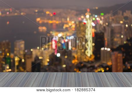 Opening wooden floor Blurred bokeh light Hong Kong office building night view abstract background
