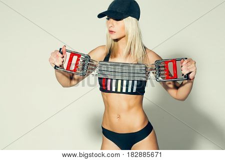 Pretty Sporty Girl Athlete Holding Resistance Band
