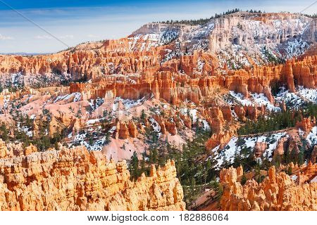 Beautiful view of Bryce Canyon National Park with snowcapped sandstone rocks, USA