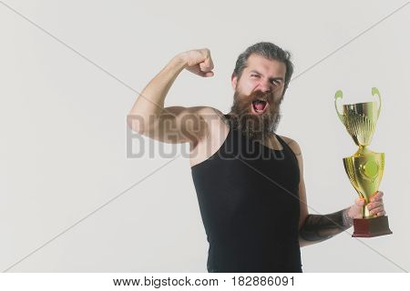 Bearded Happy Man Holds Gold Champion Cup On Grey Background