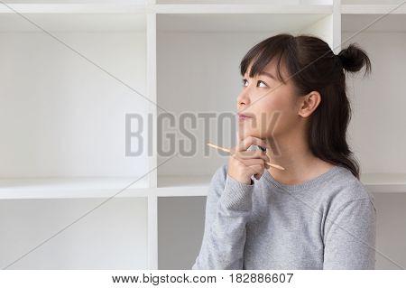 Asian Girl Female Teenager Student Thinking Something Beside Bookshelf