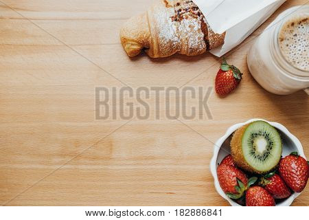 Emty Space For Text. Sweet Breakfast With Coffee, Croissant, Strawberry, Kiwi On A Wooden Table