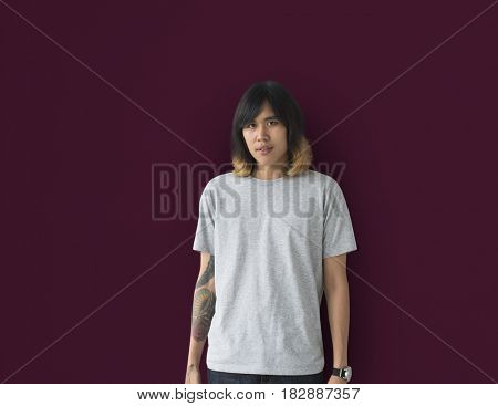 Portrait of Young Adult Asian Man with Tattoo Isolated