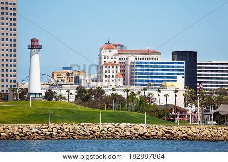Cityscape of Long Beach with lighthouse, high-risers, skyscrapers and palm trees, USA