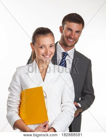 Portrait of a couple of successful young managers with documents in hands