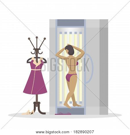 Woman in solarium. Beauty salon and spa treatment. Woman with bronze skin on white background.