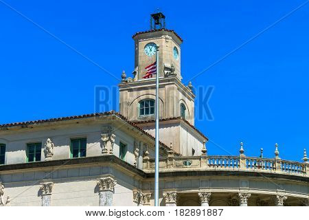The Coral Gables City Hall is a historic site in Coral Gables. The city hall was built in the Mediterranean Revival architectural style. It is three stories tall built of local limestone has a stuccoed exterior tile roof central 3-stage clock tower and a