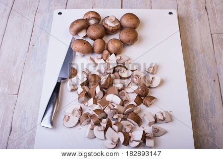 fresh cut champignons on white background meal
