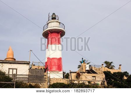 Red and white Old inactive Lighthouse located on a hilltop above the old Jaffa Port Israel Mediterranean. Gorizontal view