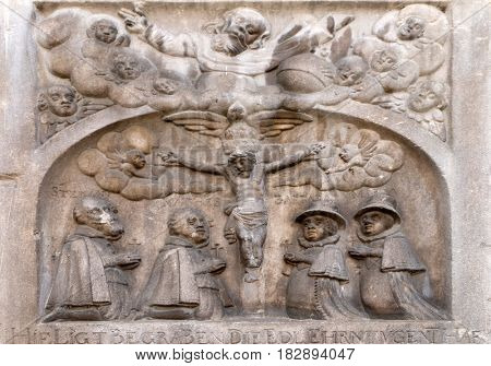 MARIBOR, SLOVENIA - APRIL 03: Crucifix, bas relief on the facade of Cathedral of Saint John The Baptist, Slomsek square, Maribor, Slovenia on April 03, 2016.