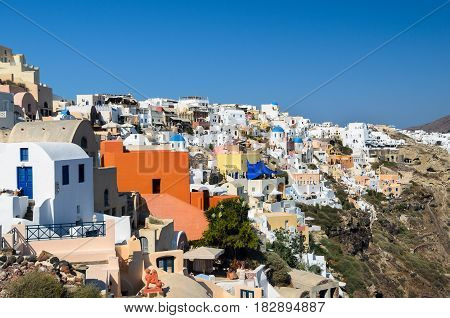 Traditional white architecture with blue churches on Santorini island, Greece
