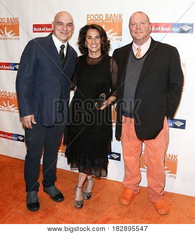 NEW YORK-APR 19: (L-R) Michael Symon, Susi Cahn and Mario Batalli attend the Food Bank for New York City's Can-Do Awards Dinner 2017 at Cipriani's on April 19, 2017 in New York City.