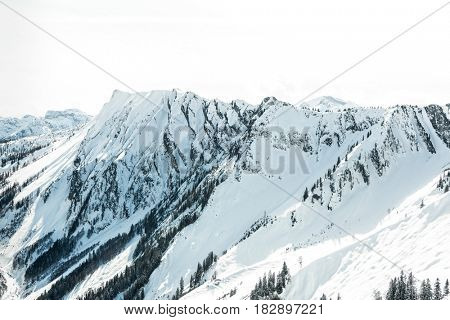 High altitude mountains peaks covered in snow in a pristine alpine landscape in winter