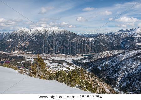 Scenic view of mountainous landscape in winter with cloudscape background