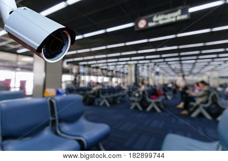 cctv security camera on blurred background of passengers waiting bording at airport security technology concept.
