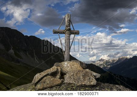 mountain cross in the austrian alps at dawn