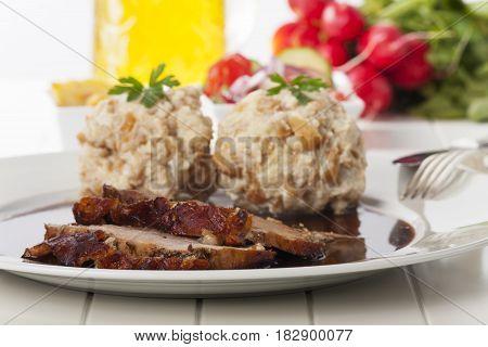 bavarian roasted pork with dumplings with beer