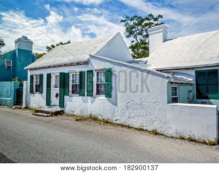 SOUTH HAMPTON BERMUDA - May 27 2016: A typical home with white painted roof to collect water is commonplace in South Hampton on May 27 2016 and all of Bermuda.