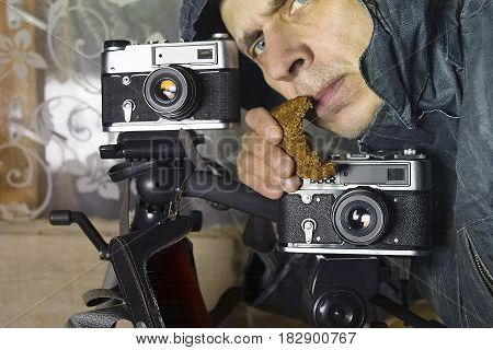 Photographer holding a slice of bread in his studio concept of work for food. Closeup cropped shot
